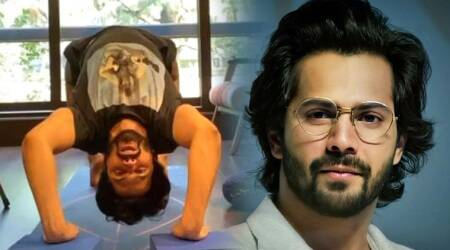 varun dhawan, yoga, wheel pose