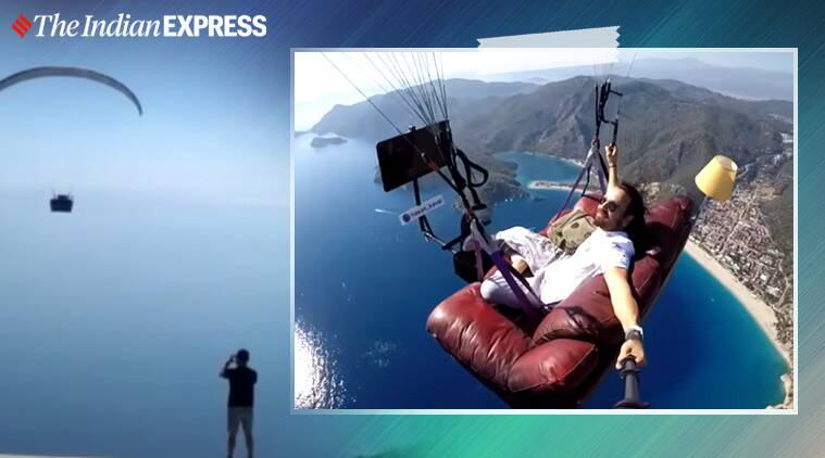tom and jerry, man paragliding sofa watches tom and jerry viral video,