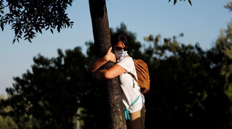 Israel, Coronavirus, COVID-19, hugging trees, Lockdown blues, COVID-19 lockdown, social distancing, Trending news, Indian Express news