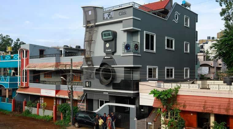 camera shaped house, karnataka viral camera house, ravi hongal camera house, photographer sons named after camera, belgaum camera house, viral news, odd news, indian express