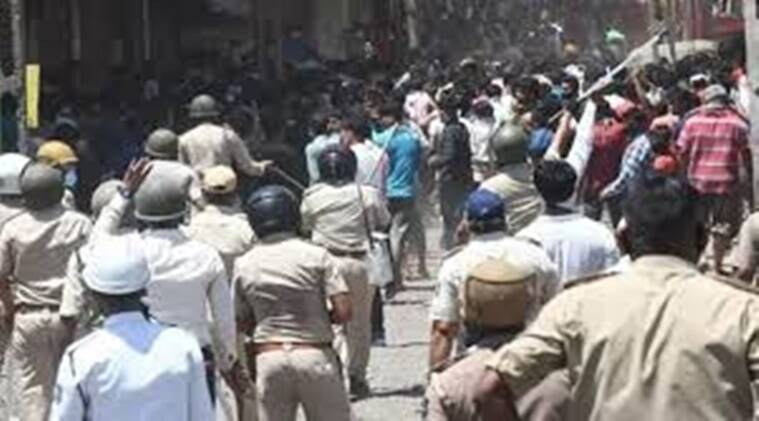 covid-19 lockdown in gujarat,migrant workers in gujarat, migrant workers clash with gujarat police, migrant workers move to high court for bail, gujarat high court indian express news