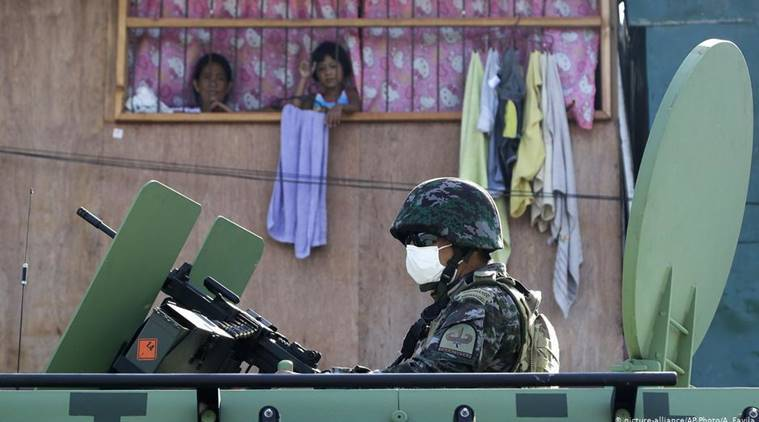 Philippine capital returning to lockdown as virus surges