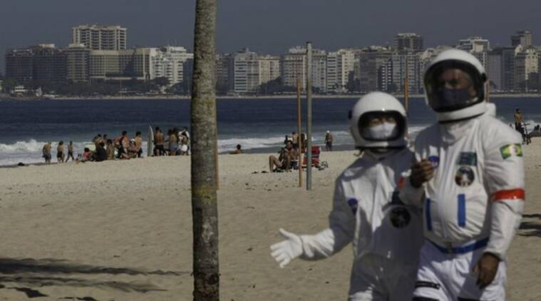 Brazil, COVID-19, Brazilian couple, Spacesuit, Coronavirus, Trending news, Rio de Janeiro, Indian Express news