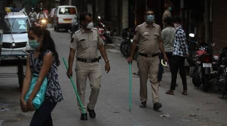 delhi, delhi news, delhi cop beating child video, delhi cop suspended, indian express