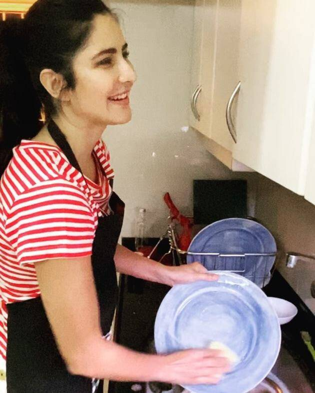 Katrina washing the utensils