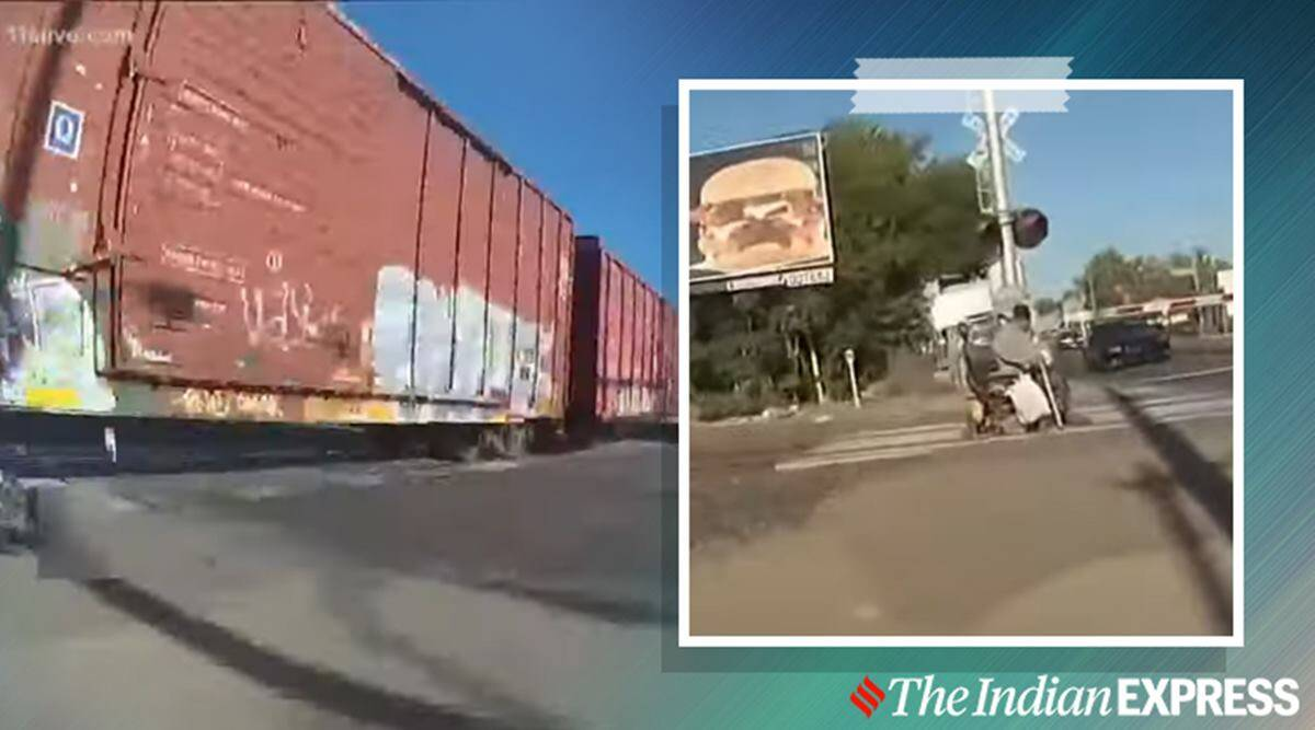 policewoman saves man in wheelchair, officer saves man in wheelchair from train, viral video, trending, indian express, indian express news