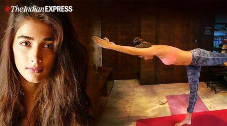 Warrior pose, warrior pose III, virbhadrasana III, pooja hegde fitness, fitness goals, indianexpress.com, indianexpress,