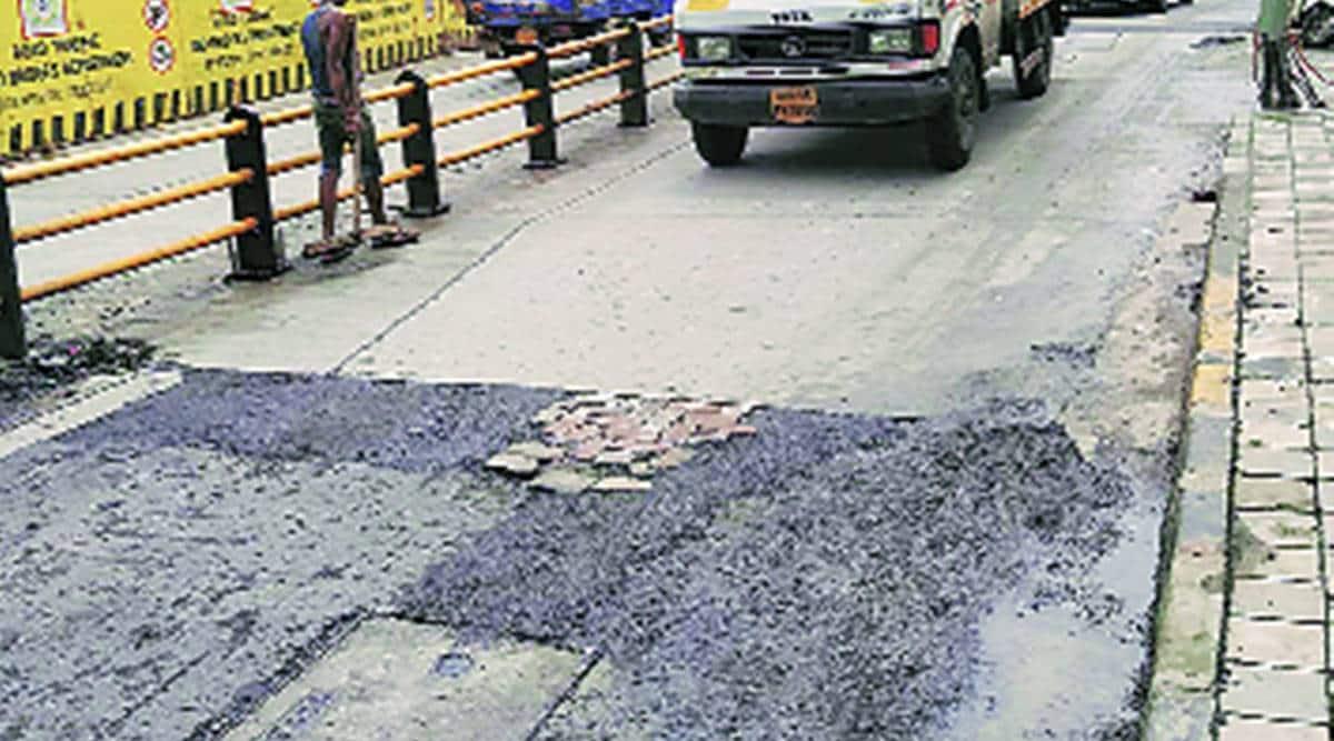 SNDT nullah bridge, Juhu Tara Road potholes, BMC, Mumbai news, Indian express news