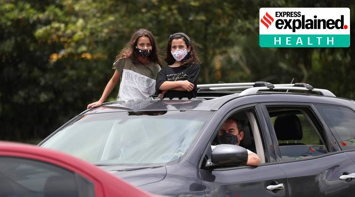 masks in public places, masks compulsory in cars, fine for not wearing masks in cars, express explained, indian express