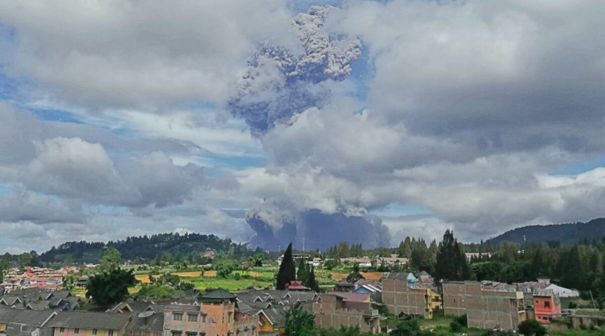 The Sinabung volcano in Indonesia emits towering ash