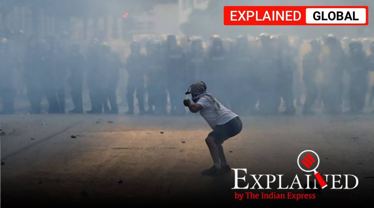 lebanon protests, beirut blast, beirut explosion, beirut protests, lebanon government resigns, Hassan Diab, indian express
