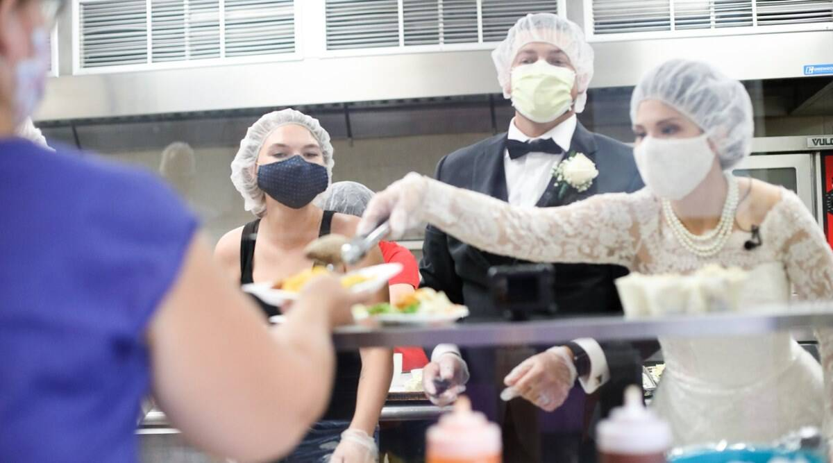 newlyweds donate and serve wedding food to shelter, ohio couple donate wedding food to shelter, couple wedding reception local women shelter, viral news, good news, covid weddings, indian express