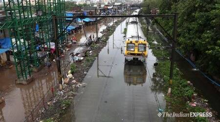Mumbai: Waterlogging hits local train services, NDRF called in to rescue stranded passengers