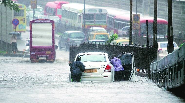 mumbai floods, mumbai rains, mumbai rain damage, mumbai covid centre rain damage, mumbai water logging, bmc, indian express news