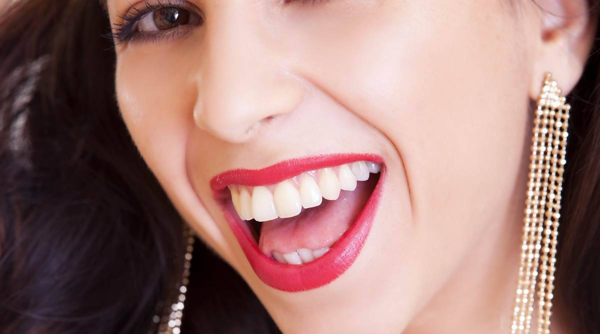 teeth whitening, natural ways to whiten the teeth, teeth whitening at home, using turmeric for teeth whitening, indian express news