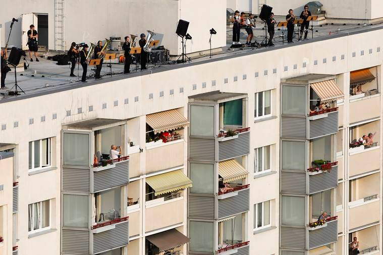 Musicians Germany perform concert apartment roofs, Dresden, music concert, alphorns, Dresdner Sinfoniker orchestras, trending, indian express, indian express news