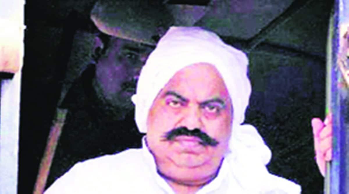 Prayagraj police, gangster Ateeq Ahmad, govt land occupied by gangster Ateeq Ahmad, gangster act, indian express news