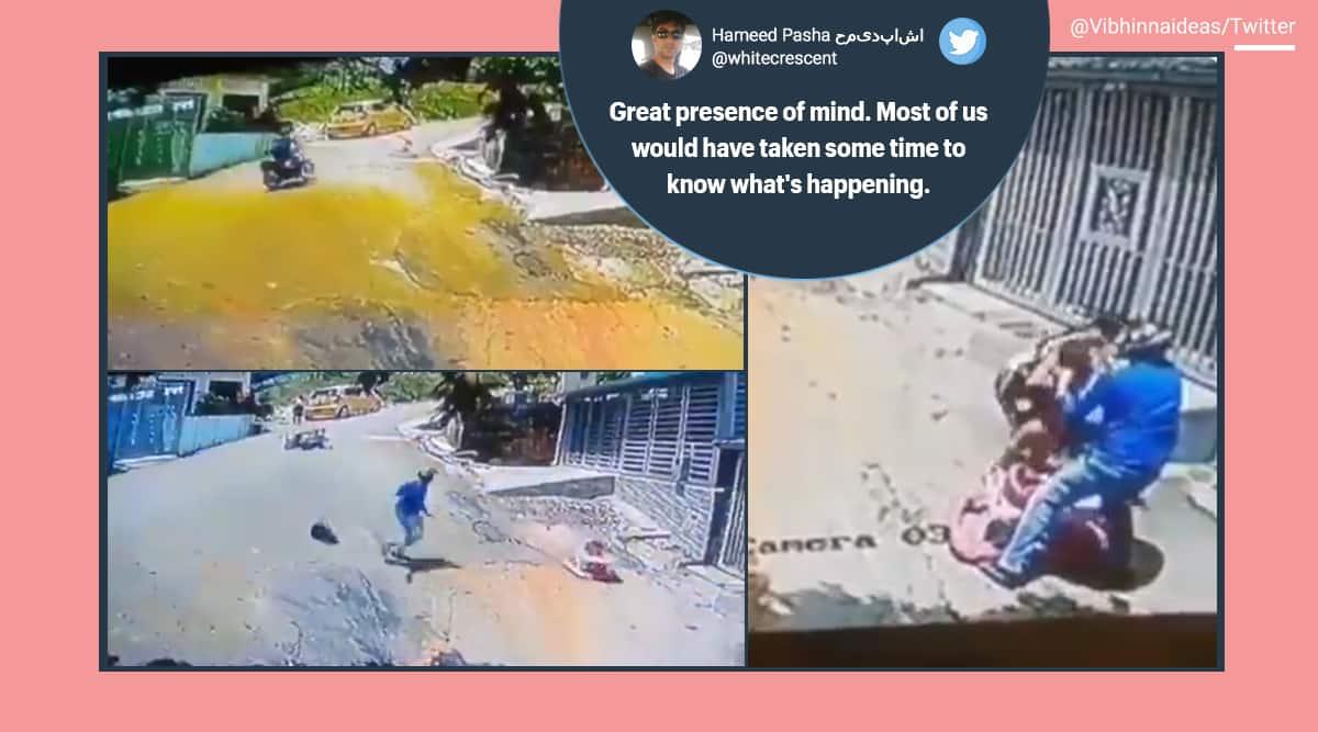 Toddler videos, biker man, Toddler in walker, Colombia, Viral video, Toddler in walker accident, baby videos, Trending news, Indian Express news.
