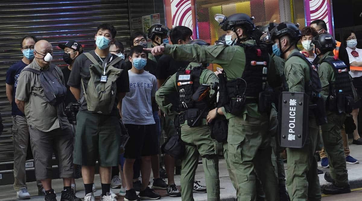 Hong Kong, Hong Kong Police, Hong Kong Police tackle girl, Hong Kong protests, Hong Kong anti-sedition law protests, anti-sedition law protests Hong Kong, world news, Indian Express