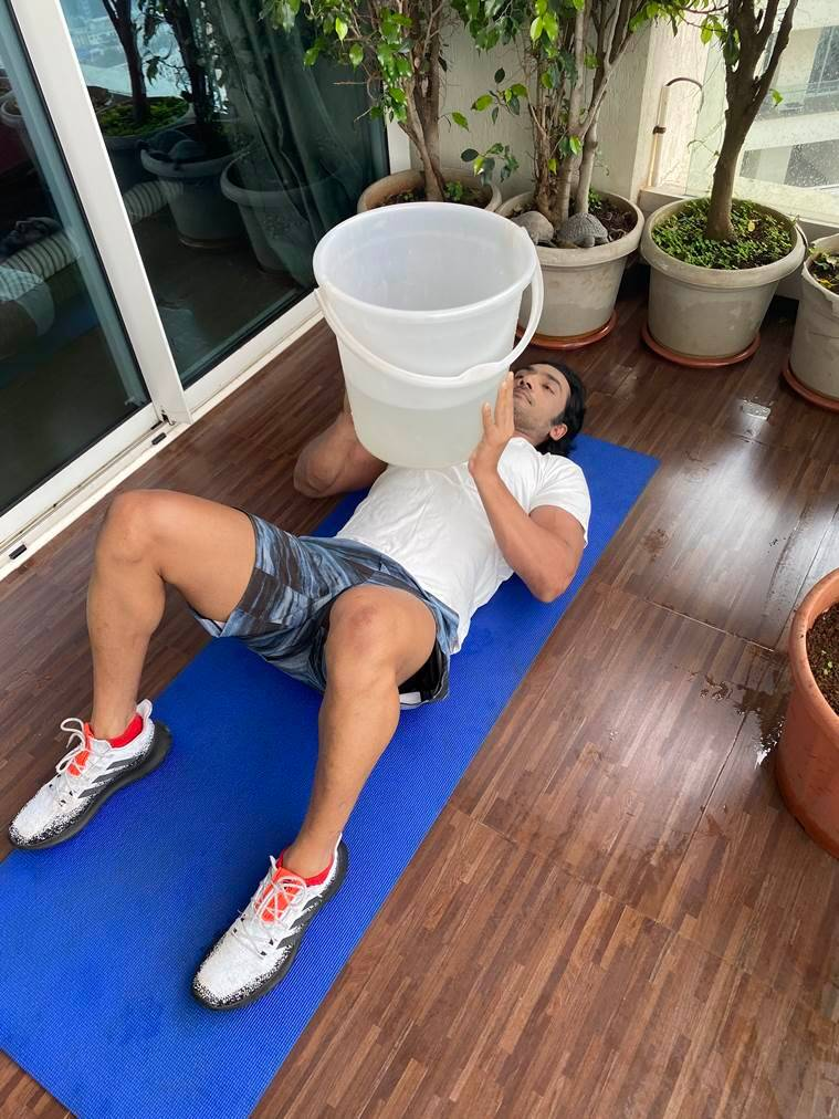 working out, working out at home, home workouts, easy workouts to try at home, working out using buckets, using buckets for fitness, indian express news
