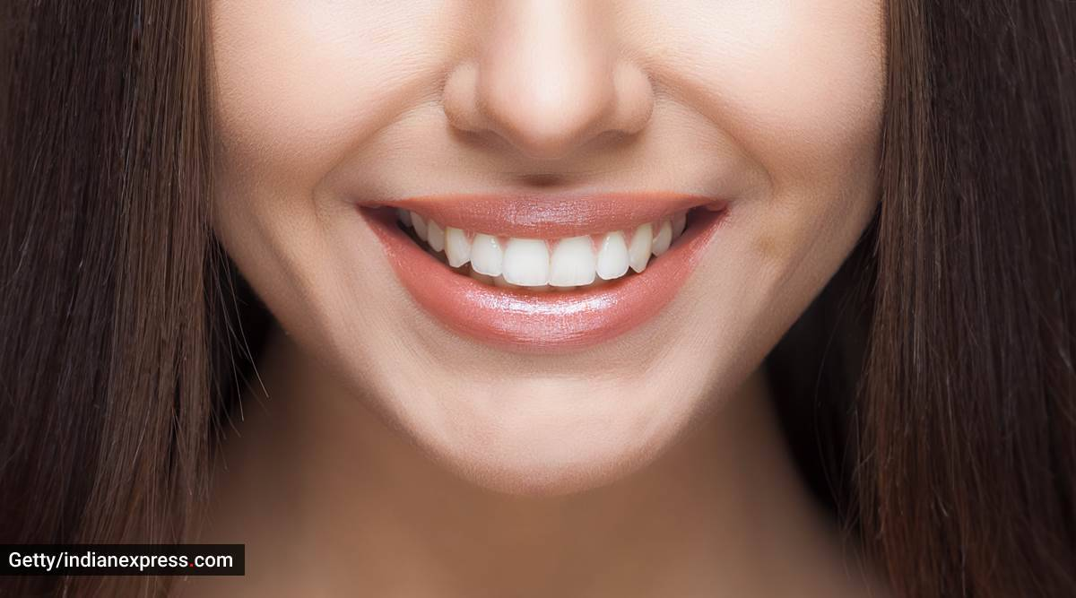 white teeth, how to get whitened teeth, white teeth, ayurvedic ways for white teeth, what is oil pulling, how to do oil pulling, indianexpress.com, indianexpress, tongue scrapping, how to do tongue cleaning, ayurveda remedies for white teeth, dixa bhavsar,