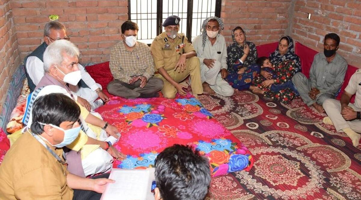 J&K L-G visits families of labourers killed in Shopian, assures 'justice at all costs'