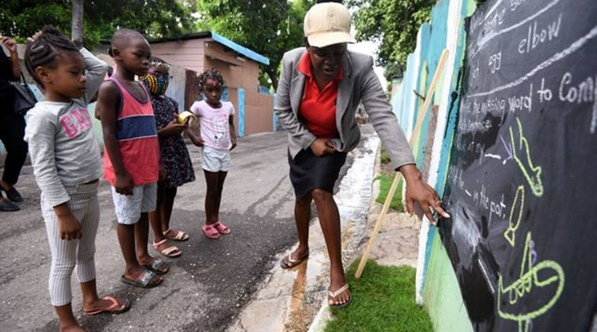 Jamaica, wall backboards, Coronavirus, education, COVID-19 Jamaica updates, Trending news, Indian Express news, lesson on wall painted backboards.