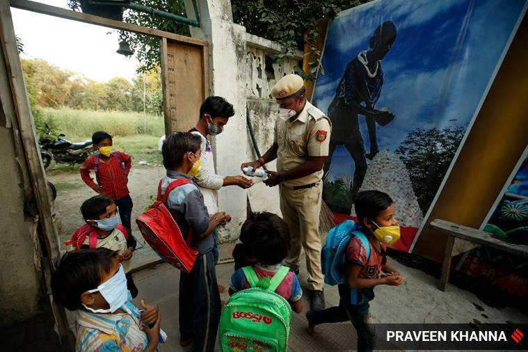 For 20 kids living near Red Fort, cop dons teacher's hat