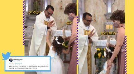 Watch: Priest raises hand to bless little girl, she gives him a high five