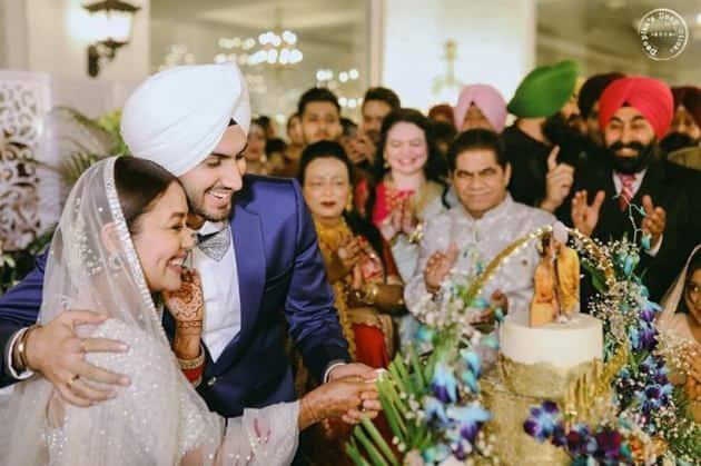 neha kakkar wedding photos, neha kakkar, neha kakkar reception, neha kakkar wedding, neha kakkar marriage, neha kakkar husband, neha kakkar rohanpreet singh photos