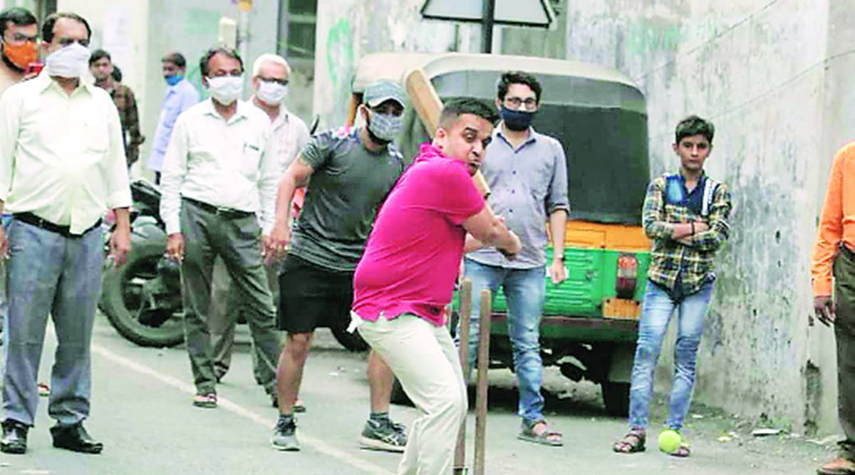 BJP MLA played cricket, BJP MLA flouted Covid norms, SUrat Covid restrictions, Surat news, Gujarat news, Indian express news