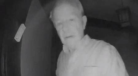 Nobel Prize winner Robert Wilson knocks on neighbour Paul Milgrom's door to inform him that he won; wife sees live on security-camera