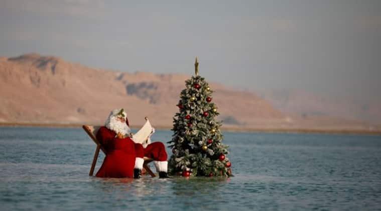 Santa clause, Dead sea, Israel's Tourism Ministry, Santa Clause dead sea swim, Israel Christmas season, coronavirus, COVD-19, Christmas 2020, Christmas cheer, dead sea, trending news, Indian Express news