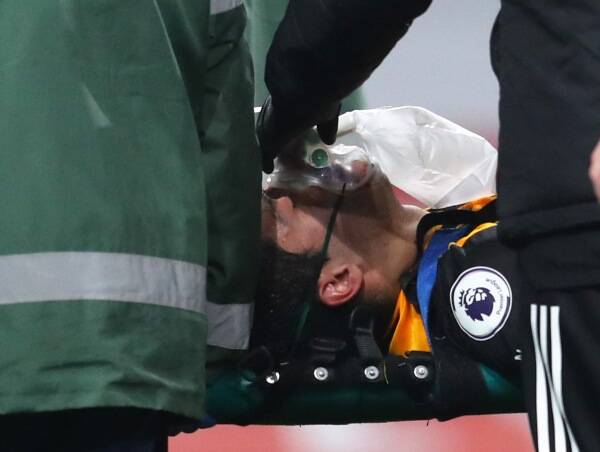 Clash of heads: Raul Jimenez leaves game with head injury after colliding with David Luiz