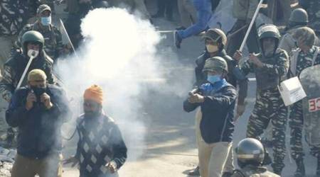 Farmers brave water cannons, tear gas in march towards Delhi