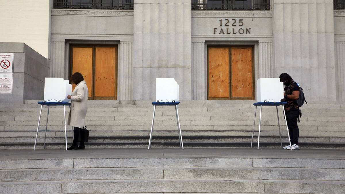 Despite fears of violence, election day proceeds smoothly as millions line up to vote