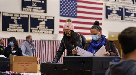 Officials count early votes at the Roberto Clemente Coliseum where social distancing is possible amid the COVID-19 pandemic, during general elections in San Juan, Puerto Rico, Tuesday, Nov. 3, 2020. (AP Photo: Carlos Giusti, File)