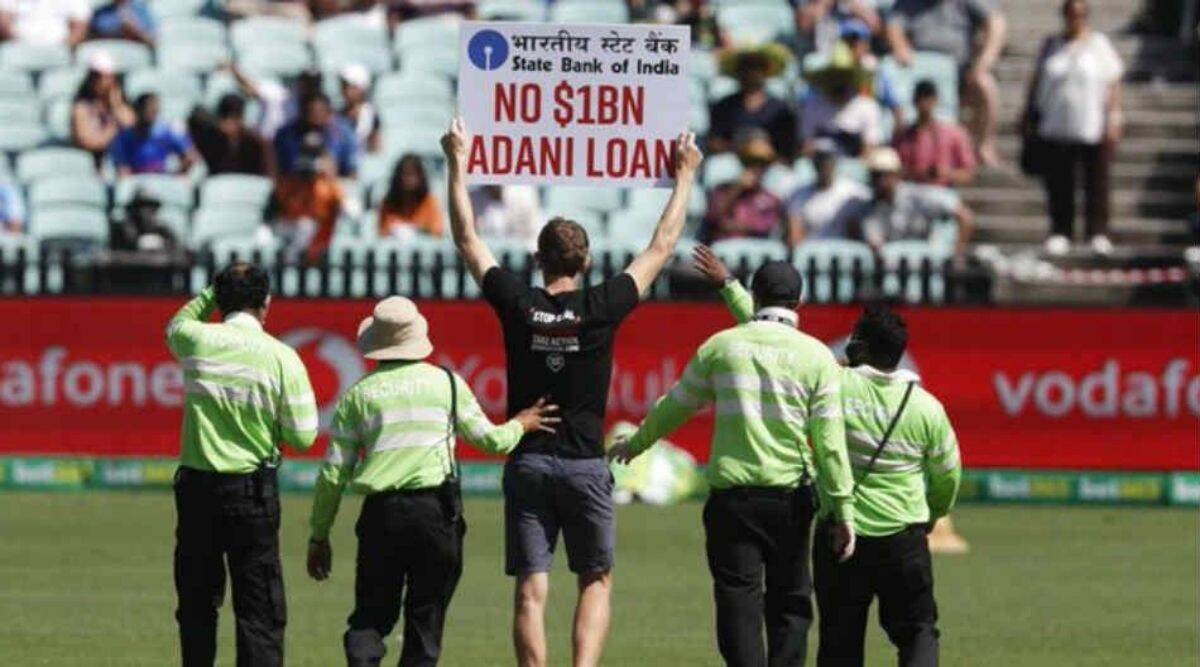 Two protesters enter field with placards during India-Australia ODI