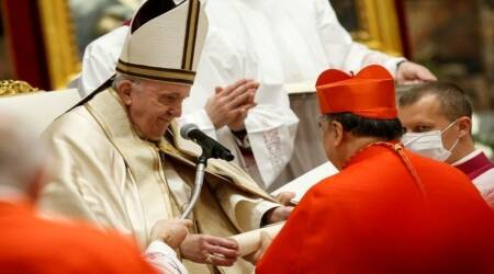 Felipe Arizmendi of Mexico receives his biretta as he is appointed cardinal by Pope Francis