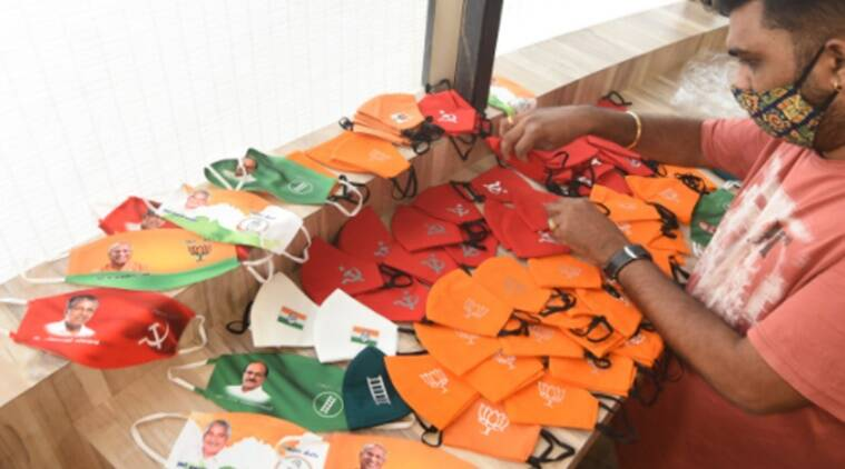 Kerala, political face masks, face masks as a campaign strategy, facemasks campaign tool, COVID-19, campaign strategies, Local body elections, Kerala news, Kerala local body election, Kerala panchayat elections, election campaign amid coronavirus, Kerala Coronavirus updates, Indian Express news.