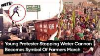Young Protester Stopping Water Cannon Becomes Symbol Of Farmers March