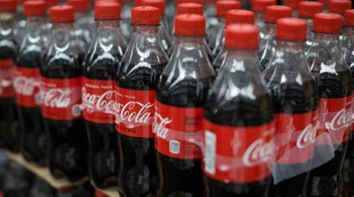Coca cola, Coca-cola, Coca Cola company, Covid-19, Coronavirus pandemic, layoffs, business loss, Indian Express News, Indian Express