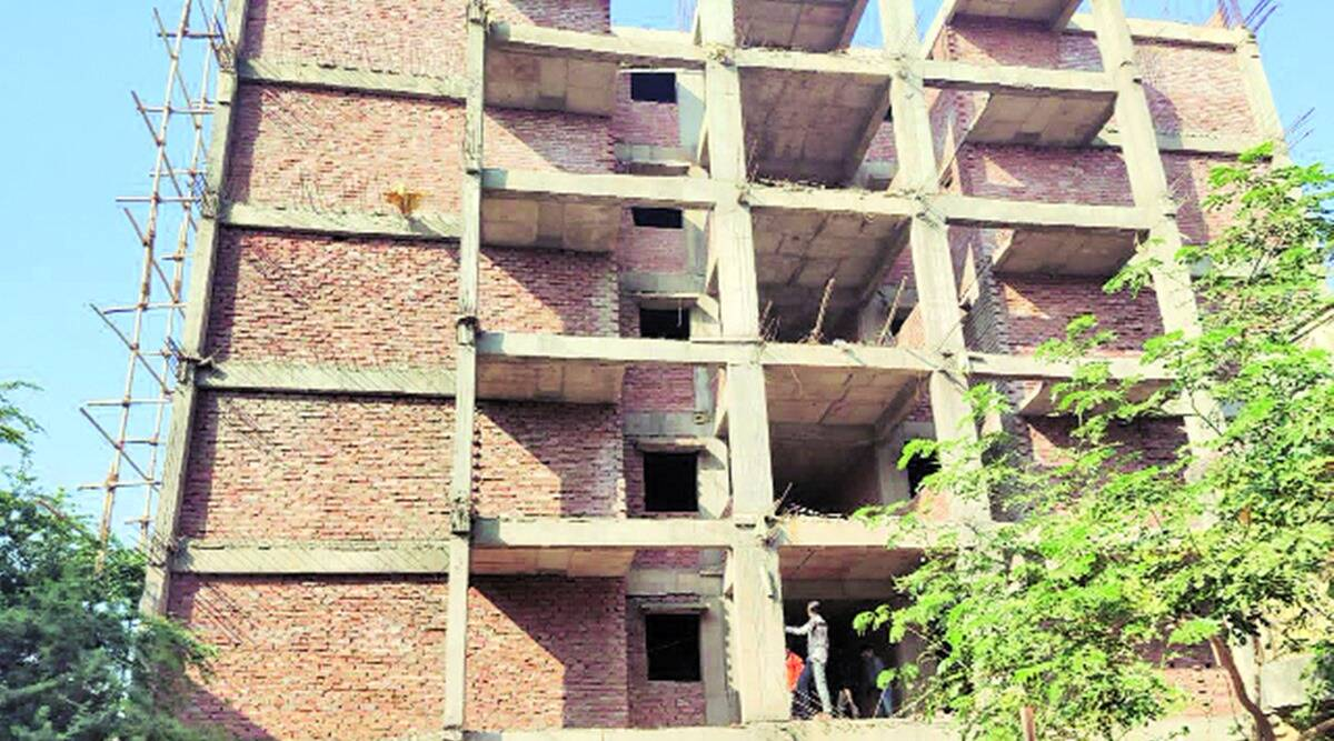 AMC, ahmedabad police, gangster abdul latif under construction building demolished, gangster abdul latif building demolished, gujarat news, indian express news