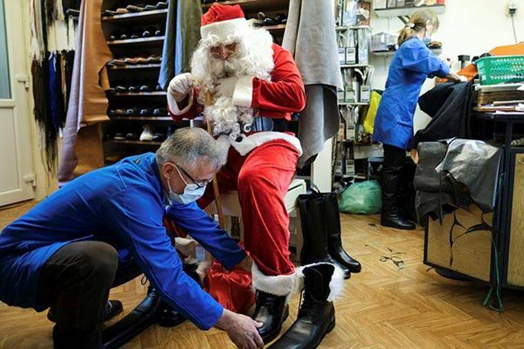 Romania, cobbler, Romania viral story, Romanian cobbler designs size-75 winter boots to stamp out COVID-19, coronavirus, shoes, trending, indian express, indian express news