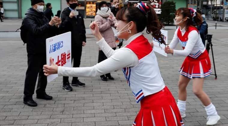 Japan, Japanese cheerleaders, a Tokyo rail station, Cheerleading during COVID-19, Coronavirus, Japan coronavirus updates, Cheerleading to lift spirits, Trending news, Indian Express news.