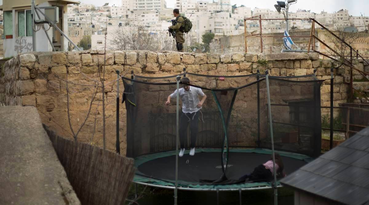 Israel moves to rein in rights group over apartheid use