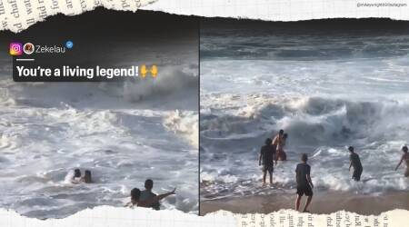 Professional surfer, Beach rescue, Beach rescue video, Surfer helps a woman from drowning, Oahu, Hawaii, Viral video, Trending news, Indian Express news.