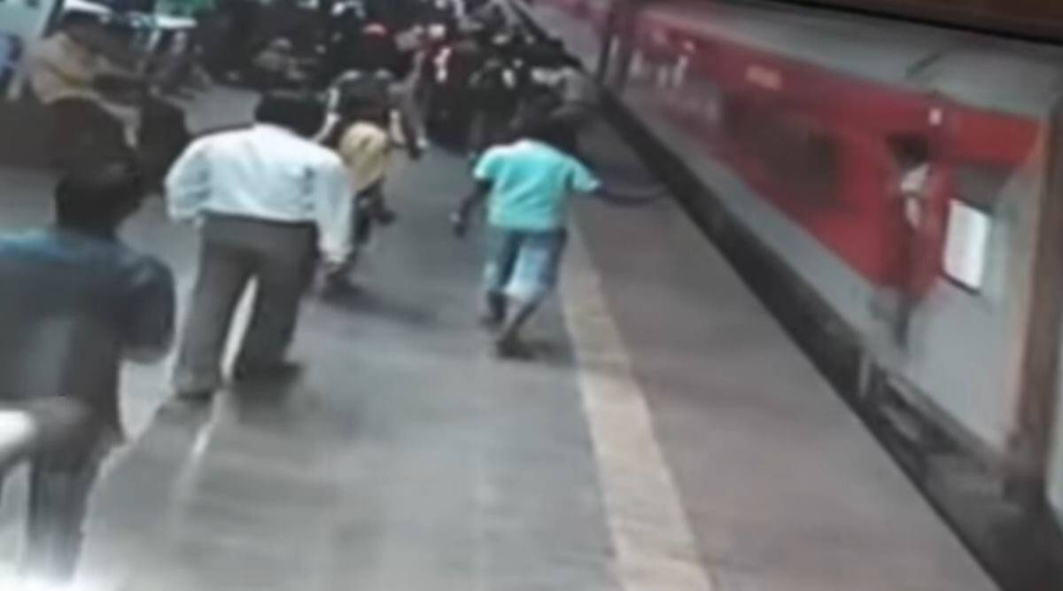 rpf personnel kalyan railway station viral video, Maharashtra Railway Cops Save Life. moving train, cctv footage, trending, indian express news