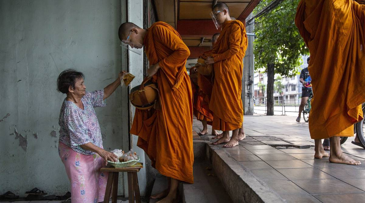 Thailand weighs new curbs to contain its biggest coronavirus wave