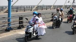 Mamata Banerjee rides pillion on electric scooter in protest against rising fuel prices